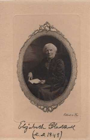 Oval portrait of Elizabeth Blackwell, seated, left pose, full face holding a book opened on her lap. Below the oval in the right side are the words Elliott & Fry. At the bottom hand written in black ink is Elizabeth Blackwell (M.D. 1849).