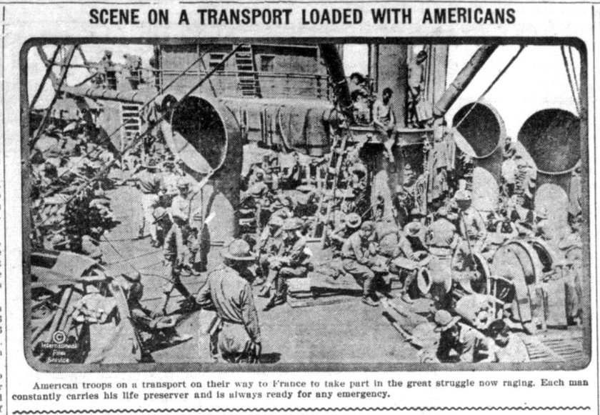 A newspaper photo of the deck of a ship crowded with men in uniform at leisure.