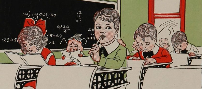 A student nibbles thoughtfully on his pencil as he thinks in class.