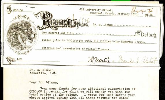 A typed document with a check attached at the top.