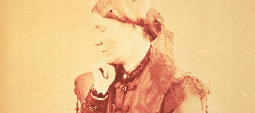 Photograph of a woman seated, left profile.