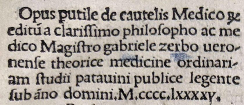 A detail of early printed text in Latin.