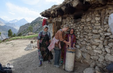 The ladies teach Marleen how to make butter from the milk.