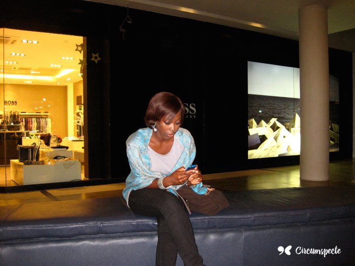 Ghanaian Blogger Jemila Abdulai tweeting at a mall in Dakar, Senegal