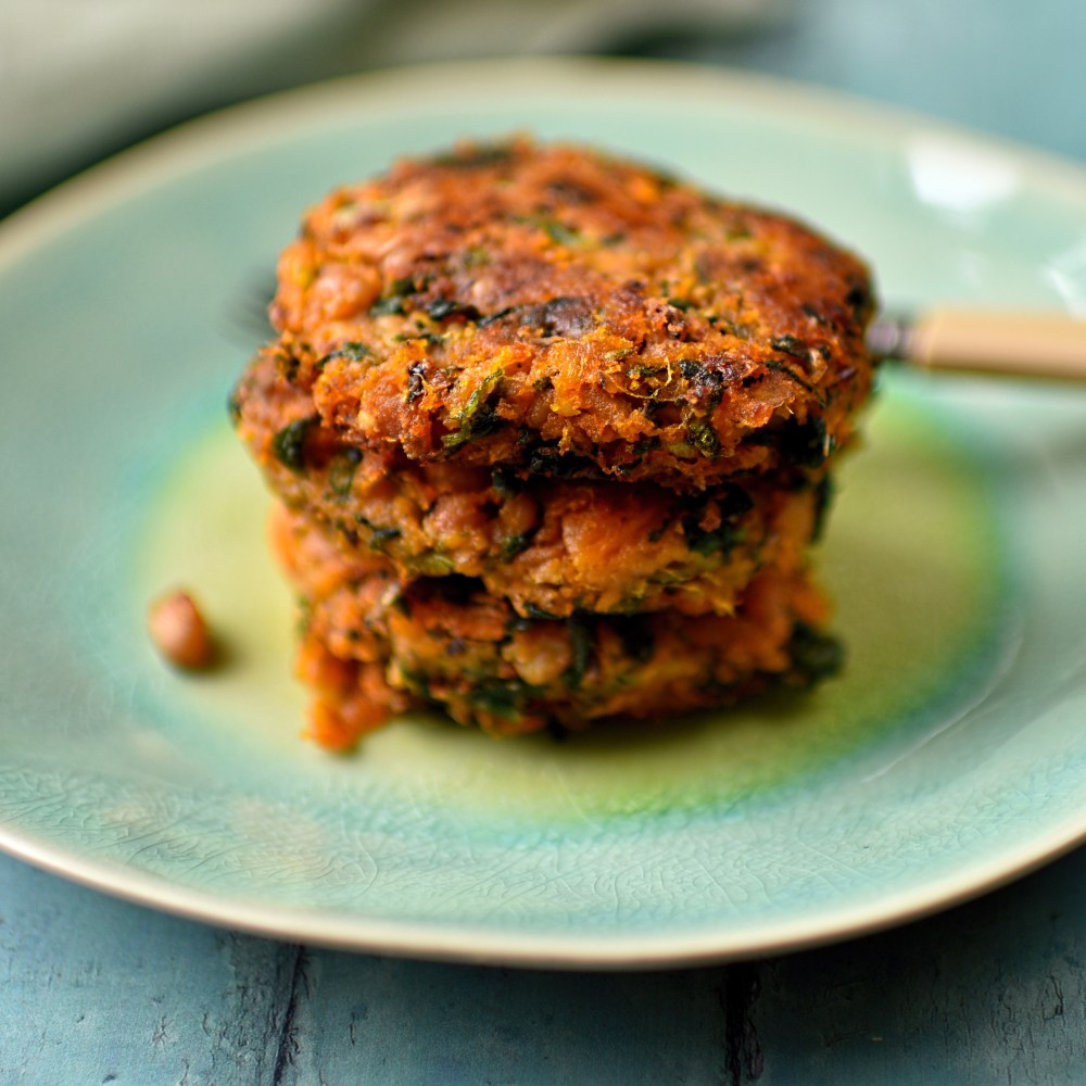 sweet potato fritters with spinach and black-eyed beans