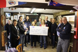 East Coast Piers race presentation of donation cheque