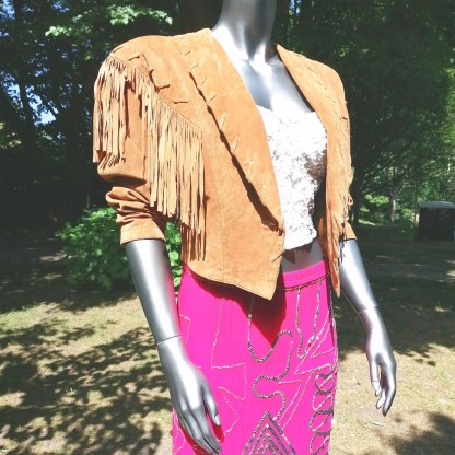 western fringe jacket with white lace top and pink silk skirt