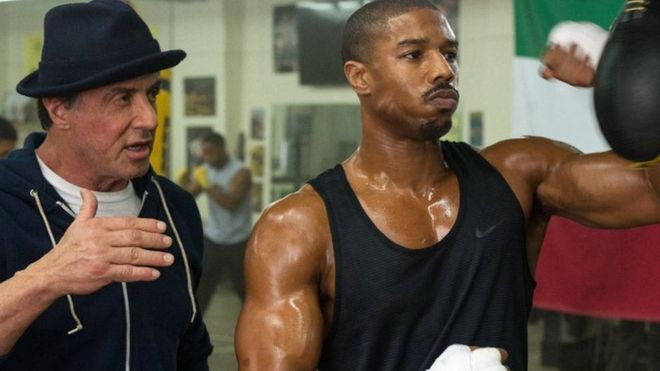 In Creed, Rocky Balboa (left) becomes trainer and mentor to the son of his late rival.