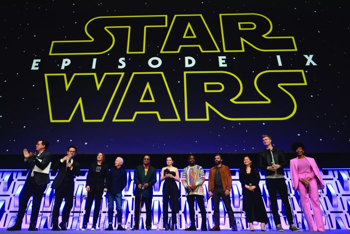 "CHICAGO, IL - APRIL 12: (L-R) Moderator Stephen Colbert, Director J.J. Abrams, Producer Kathleen Kennedy, Anthony Daniels (C-3PO), Billy Dee Williams (Lando Calrissian), Daisy Ridley (Rey), John Boyega (Finn), Oscar Isaac (Poe Dameron), Kelly Marie Tran (Rose Tico), Joonas Suotamo (Chewbacca) and Naomi Ackie (Jannah) onstage during ""Episode IX"" panel at the Star Wars Celebration at McCormick Place Convention Center on April 12, 2019 in Chicago, Illinois.  (Photo by Daniel Boczarski/Getty Images for Disney ) *** Local Caption *** Stephen Colbert; J.J. Abrams; Kathleen Kennedy; Anthony Daniels; Billy Dee Williams; Daisy Ridley; John Boyega; Oscar Isaac; Kelly Marie Tran; Joonas Suotamo; Naomi Ackie"
