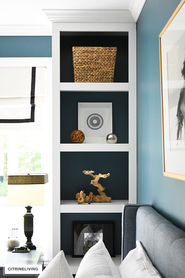 Modern coastal teen bedroom - modern wooden furniture, modern art and objects.