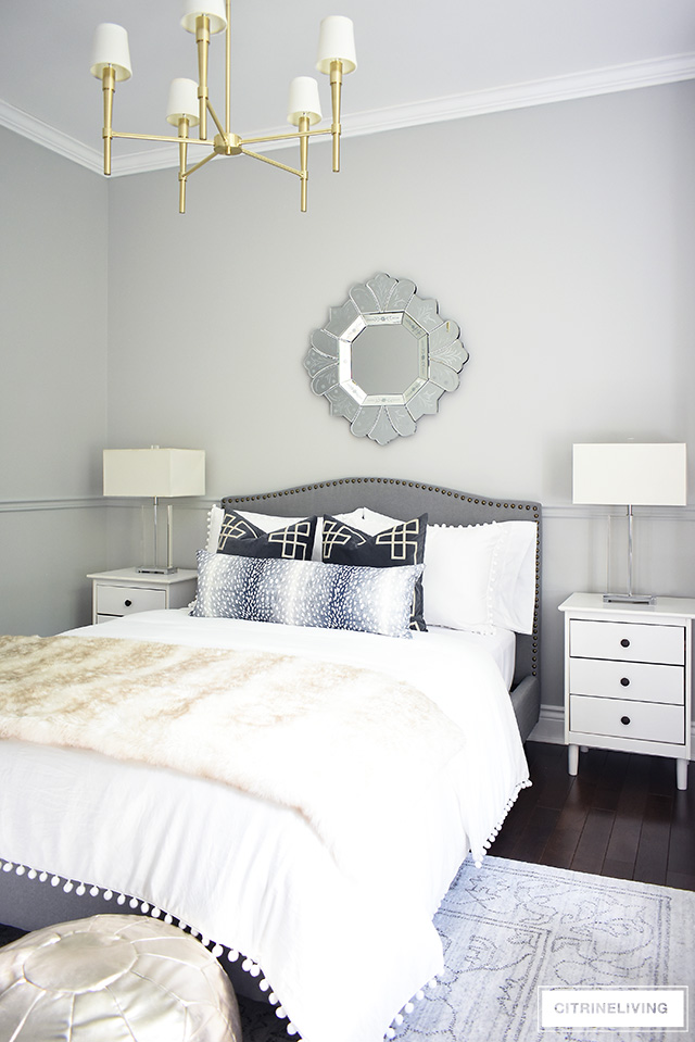 This stunning teen girl makeover is perfectly styled with neutral layers of white and gray with brass accents throughout. Crystal lamps and a brass chandelier are a chic and elegant addition!