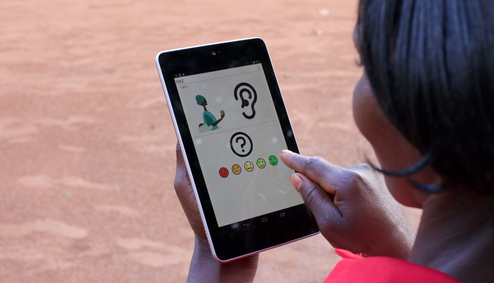 A Ugandan woman uses DevCAFE to provide feedback on effectiveness of family planning training program.