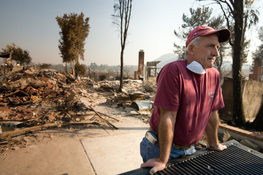 Rancho Bernardo,CA.,October 26, 2007--Long time friend of family, John Rossi, spends his day helping the Wagner family sift through their belongings following the devastating fire that destroyed their home. Andrea Booher/FEMA