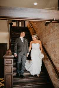 bride and groom walking down the stairs