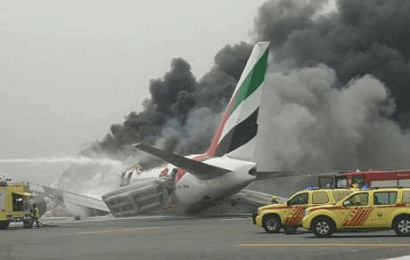 Firefighter dies as Emirates plane with 300 passengers crash-land at Dubai airport