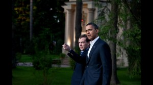 President Barack Obama and Russian President Dmitry Medvedev walk together at President Medvedev's dacha outside Moscow, Russia, July 6, 2009.