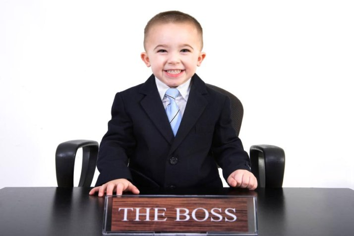 child in business suit boss