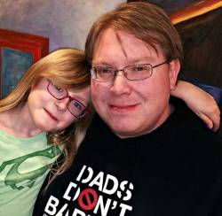 stay-at-home parents Chris Brandenberg of Twin Cities Dads Group and his daughter, August,