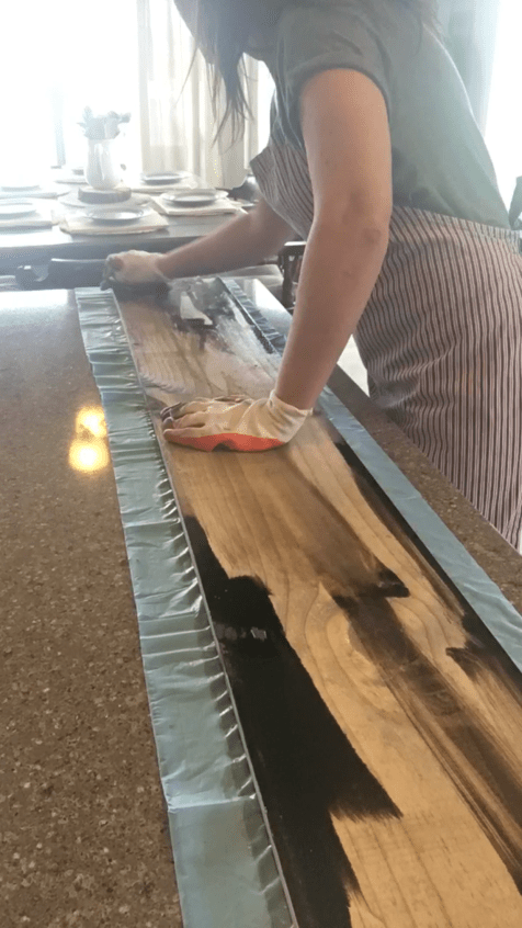 Staining a wood board