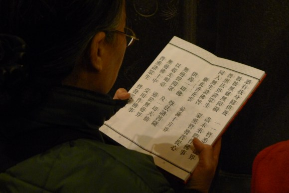 Woman with Buddhist text