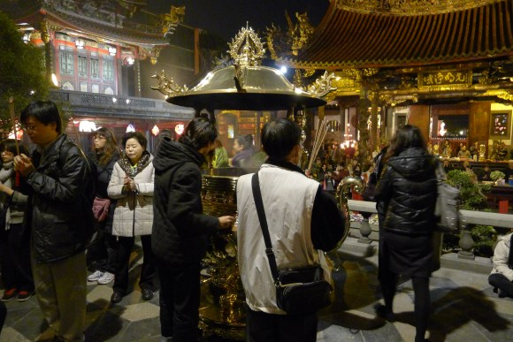 People around incense pot