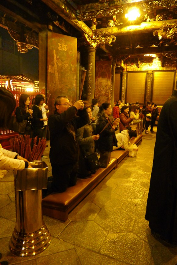 People kneeling in prayer