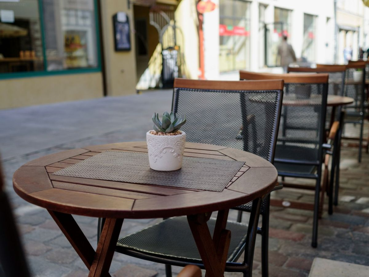 Tables and chairs in street for al fresco dining