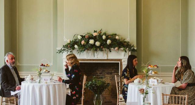 People having afternoon tea in Hylands House
