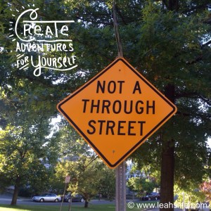 Create your own adventure.  Make it a through street.