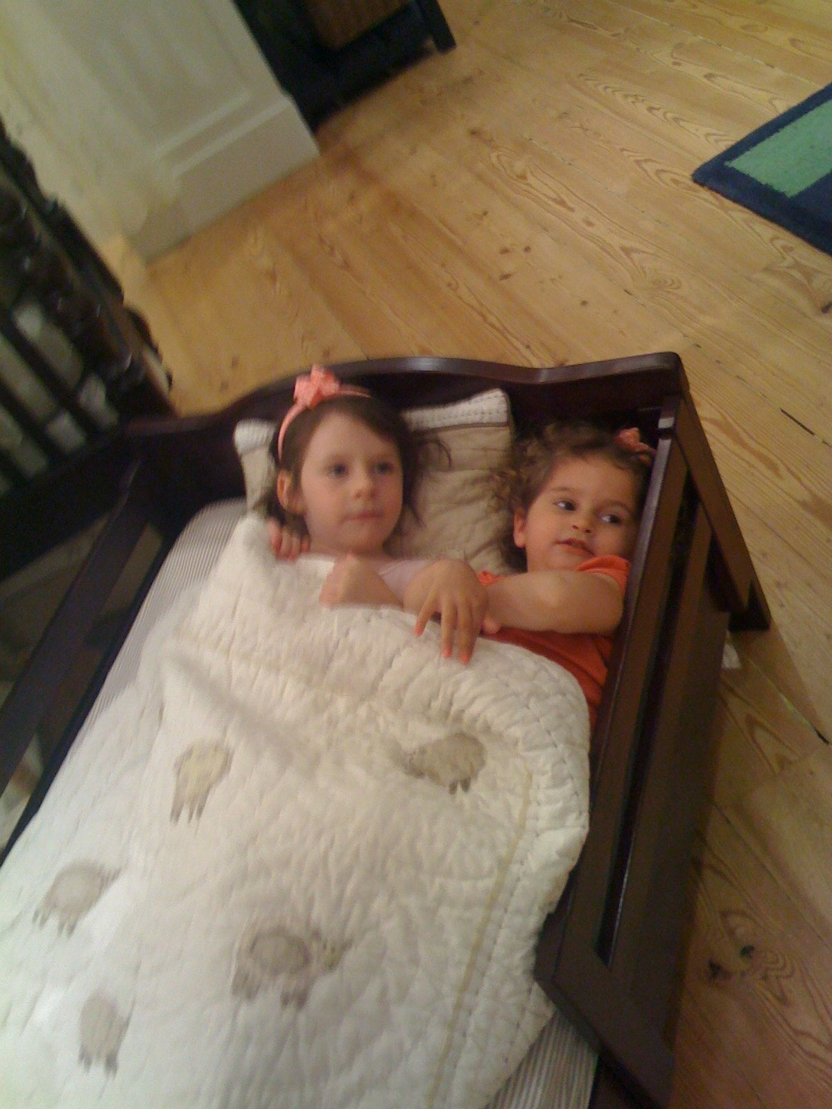 Sydney and Isabelle testing out beds at Pottery Barn Kids.