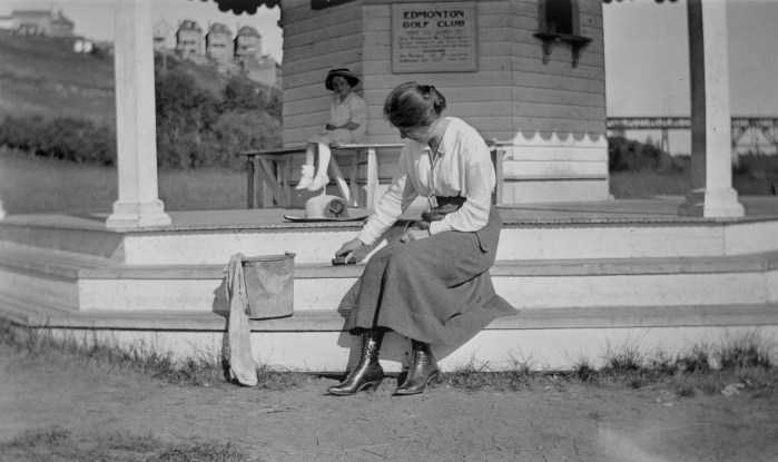Unidentified woman and child in a gazebo at the Edmonton Golf Club, circa 1913. Photo by Gladys Reeves. Provincial Archives of Alberta, A7413.