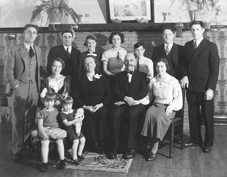 The Family of Jacob Prins. Back Row, L to R: George Prins, Simon Prins, Dorothy Prins, Winnifred Prins, Peter Prins, John Prins, Norman Prins. Front Row, L to R: Mrs. (Hendrica) George Prins with daughters Evelyn and Georgina, Mrs. Jacob Prins, Tina Prins, circa 1937. Image courtesy of the City of Edmonton Archives EA-160-3189. Do not reproduce.