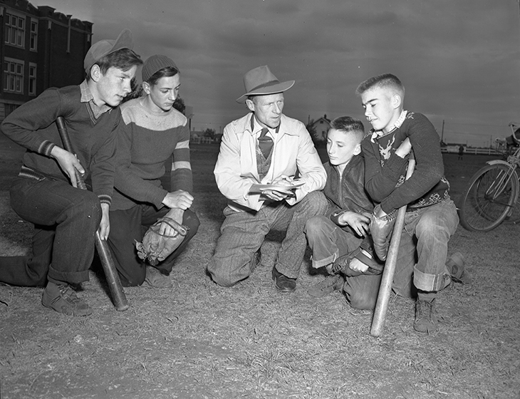 Peewee baseball team captains, Maple Leaf Athletic Club, Edmonton: Doug Hamilton, Roger Frost, Henry White and Don Scott with sports director Henry White. Image courtesy of the City of Edmonton Archives EA-600-135C.