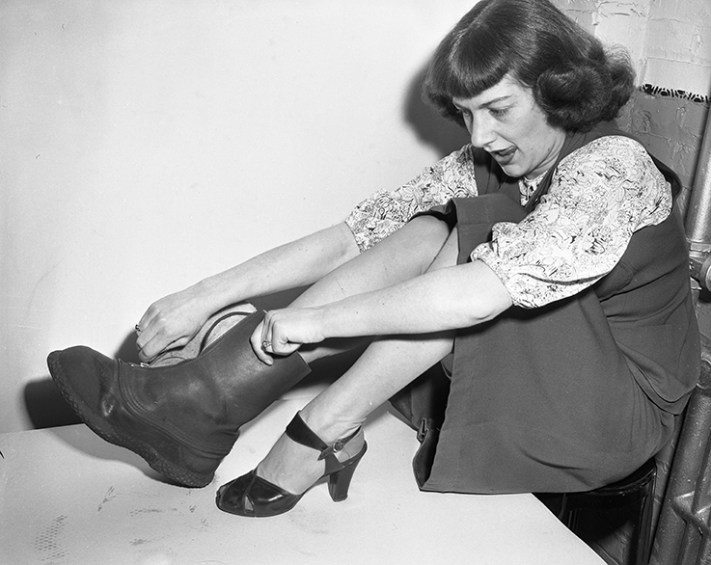 Cold weather protection. Barbara Galliver puts on boots, 1949. City of Edmonton Archives, EA-600-1935f.