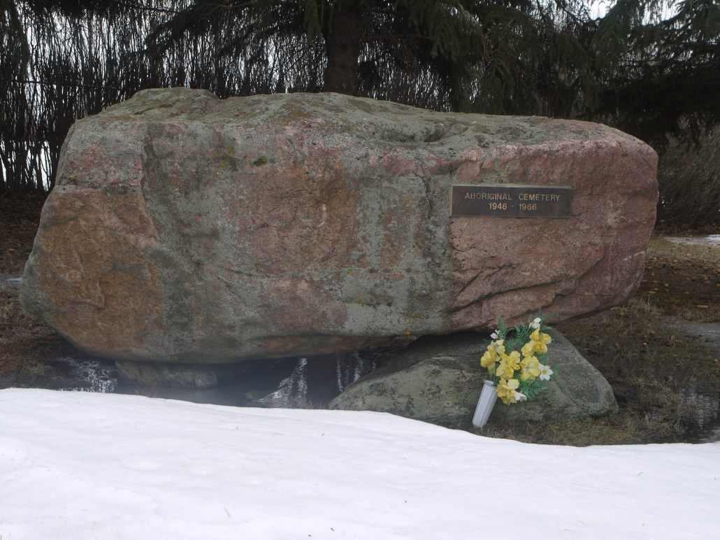 In the 1980s, this boulder was placed in the south east corner of the St. Albert Municipal Cemetery to mark the Aboriginal Cemetery. The whole cemetery sits on the land of the former Edmonton Indian Residential School.