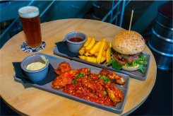 Hamburger and chips, and chicken with beer at Bentspoke Brewing Co. Photo by Gary Schafer