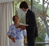 Lady Cosgrove presenting an award to Aodhan Kirk from St Francis Xavier College.