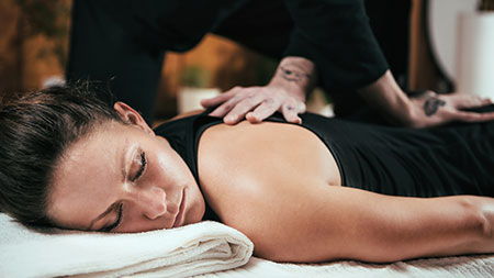 A women getting relief with a back massage