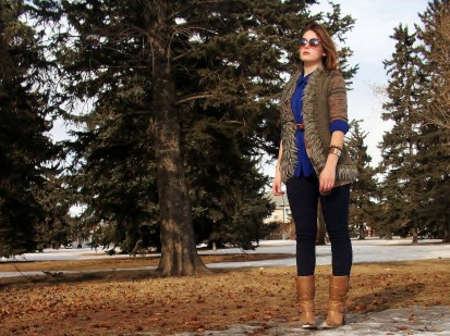 layers - chiffon top, long cardigan, fur vest, braided leather belt and boots