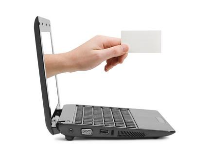 Business card coming through computer screen