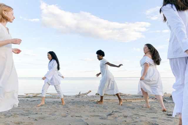 photo of women running on seaside