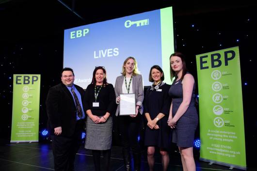 LIVES representatives collect their award from guest speaker David Hyner, left, Elaine Lilley, chief executive of The EBP, second in from right, and Kayleigh Wells, The EBP's work experience co-ordinator, right. Photo: Chris Vaughan
