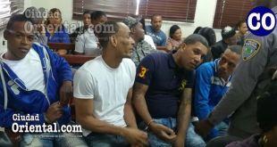 Los cuatros condenados, sentados en el banquillo de los acusados.