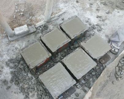 Freshly Casted Concrete Cube in Mould