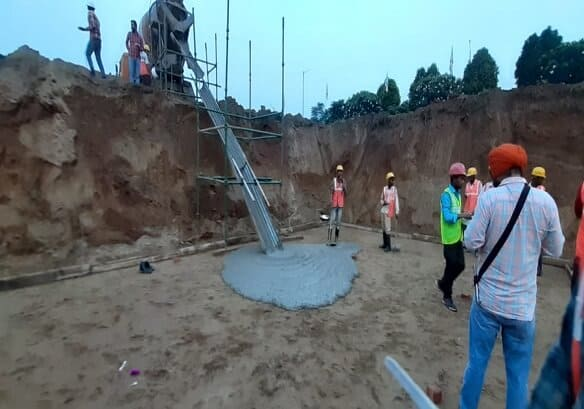 Plain Cement Concrete (PPC) Laying on Construction Site
