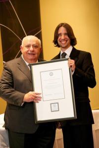 Carlos de Oliveira receives 2010 Young Alumni Achievement Medal