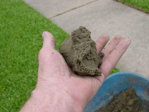 Concrete repair using dry pack method