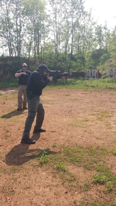 Mike demonstrates from the low ready to shooting position.