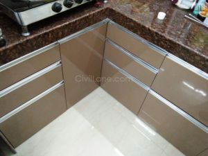 Tan Color Modular Kitchen High Gloss Laminate Finish Andheri Seven Bunglows (2)