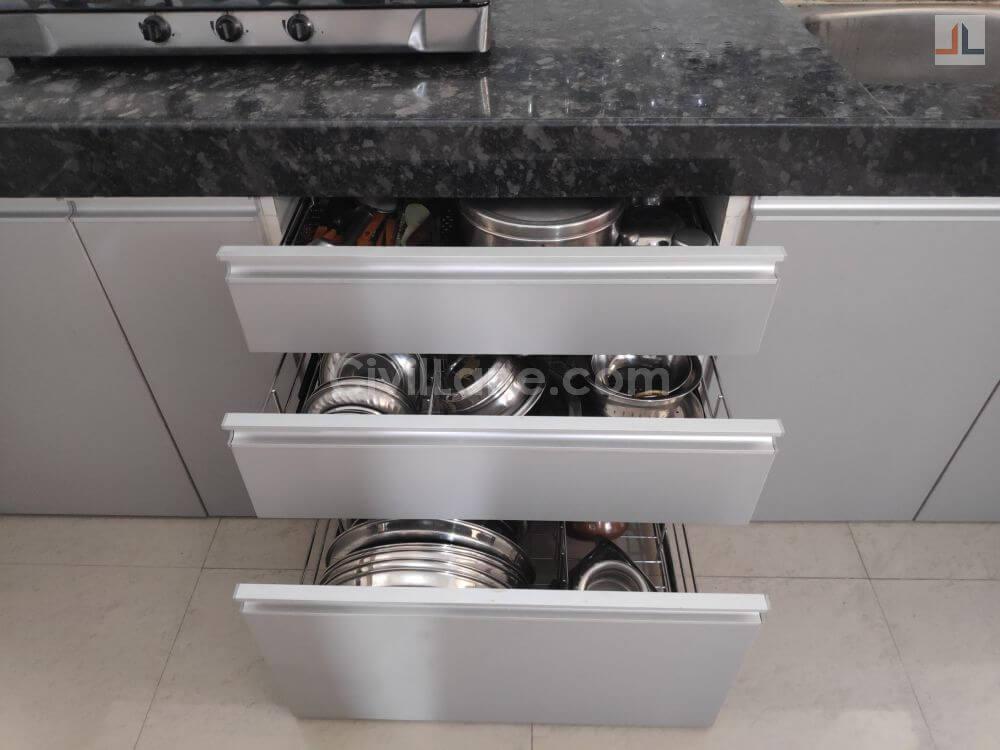 pebble grey laminate finish modular kitchen design